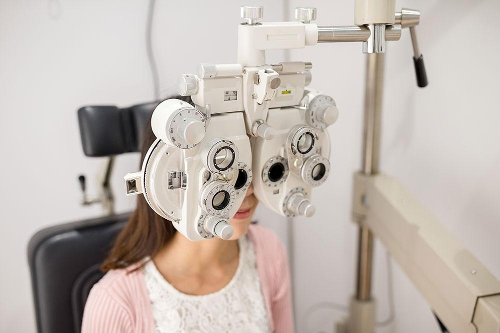 pediatric girl receiving an eye exam